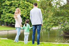 Family walking in summer park Royalty Free Stock Photo