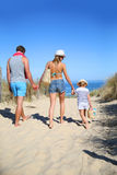 Family walking to the beach on hot summer day Royalty Free Stock Image