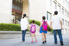 Family Walking To School With Children. Father and mother Walking To School With Children Stock Photo