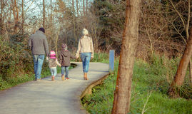 Family walking together holding hands in the Royalty Free Stock Images