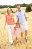Family Walking Together Through Summer Harvested F. Ield Smiling At Camera Stock Images
