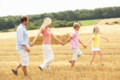 Family Walking Together Through Summer Harvested F. Ield Having Fun Royalty Free Stock Photography