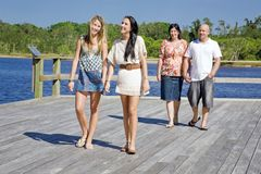 Family walking on viewing platform by the creek Royalty Free Stock Photos