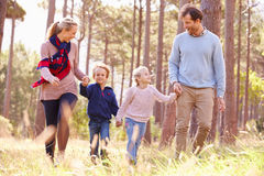 Family walking walking in the countryside Royalty Free Stock Photos