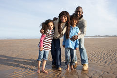 Family Walking On Winter Beach Stock Photos