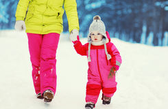 Family walking in the winter Stock Photos
