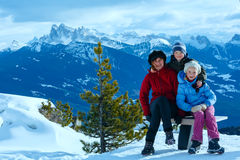 Family walking on winter mountain slope Royalty Free Stock Photography
