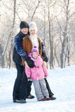 Family walking in a winter park Royalty Free Stock Photos