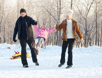 Family walking in a winter park Royalty Free Stock Photography