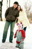 Family walking in winter park Stock Photos