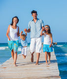 Family walking wooden jetty Royalty Free Stock Photo