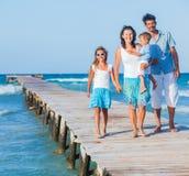 Family walking wooden jetty Stock Photo