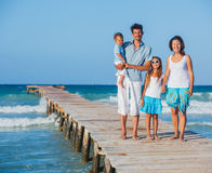 Family walking wooden jetty Stock Images