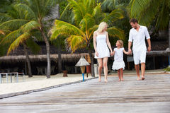 Family Walking On Wooden Jetty Royalty Free Stock Photo