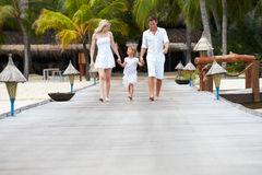 Family Walking On Wooden Jetty Royalty Free Stock Photos