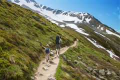 Family walks in Alps Stock Photos