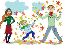 Family walks in the autumn park Stock Photo