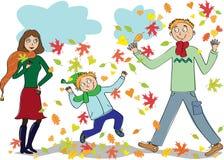 Family walks in the autumn park Stock Photo