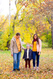 Family walks in the autumn park Stock Photography