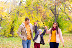 Family walks in the autumn park Royalty Free Stock Images