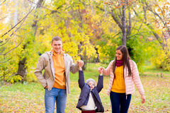 Family walks in the autumn park Stock Photos