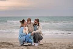 Happy family on a beach. stock photo