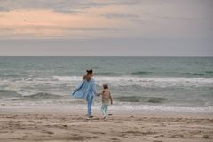 Mom and son on the beach. stock images