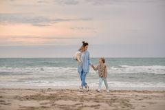 Mom and son on the beach. royalty free stock images