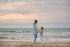 Mom and son on the beach. stock photo