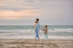 Mom and son on the beach. royalty free stock photography