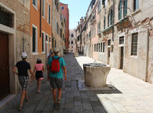 Family walks through the narrow street of venice and an ancient Royalty Free Stock Photography