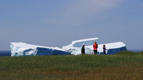 Family Walks Past Icebergs in Goose Cove Stock Photography