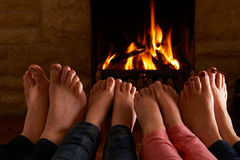 Family Warming Feet By Fire Royalty Free Stock Photo