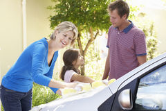 Family Washing Car Together Royalty Free Stock Images