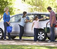 Family Washing Car Together Stock Images