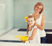 Family washing kitchen Royalty Free Stock Photography