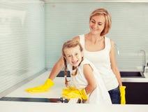 Family washing kitchen Royalty Free Stock Photos