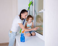 Family washing windows. Stock Photos