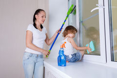Family washing windows. Stock Image