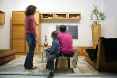 Family watch TV. In room Stock Photography