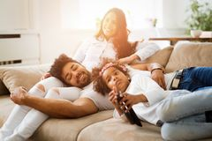 Family watches movie while sitting on the couch. Happy family watches movie while sitting on the couch Royalty Free Stock Image