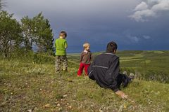 Family watches summer storm Stock Photo