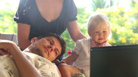 Family Watching Cartoon on Laptop stock footage