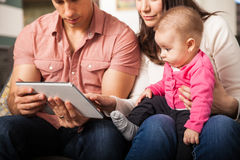 Family watching cartoons on a tablet computer Royalty Free Stock Photos