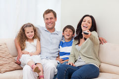 Family watching comedy together Royalty Free Stock Photos