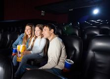 Family Watching Film In Cinema Theater Stock Photo