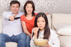 Family watching films at home Stock Images