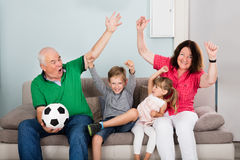 Family Watching Football Match On Television. Family Of Soccer Fans Watching Football Match On Television With Children Royalty Free Stock Photos