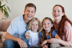 Family watching a funny movie Royalty Free Stock Image