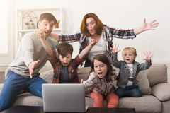 Family watching game together and cheering team. Family watching game and cheering their favorite team. Parents watching tv with children at home, spending time Stock Images